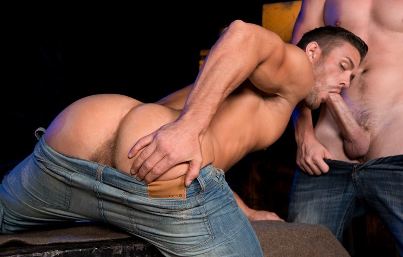 Andrew Stark lies on his back letting Ryan Rose fuck him hard and deep