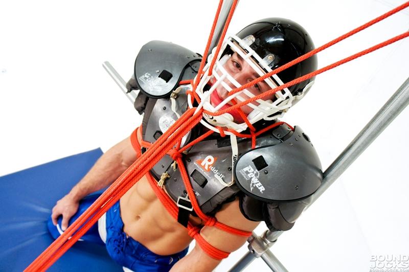 BoundJocks-Bound-gagged-muscle-jock-Marc-Dylan-football-uniform-hogtied-bdsm-Knotty-Brent-suck-giant-dick-blowjob-010-tube-video-gay-porn-gallery-sexpics-photo