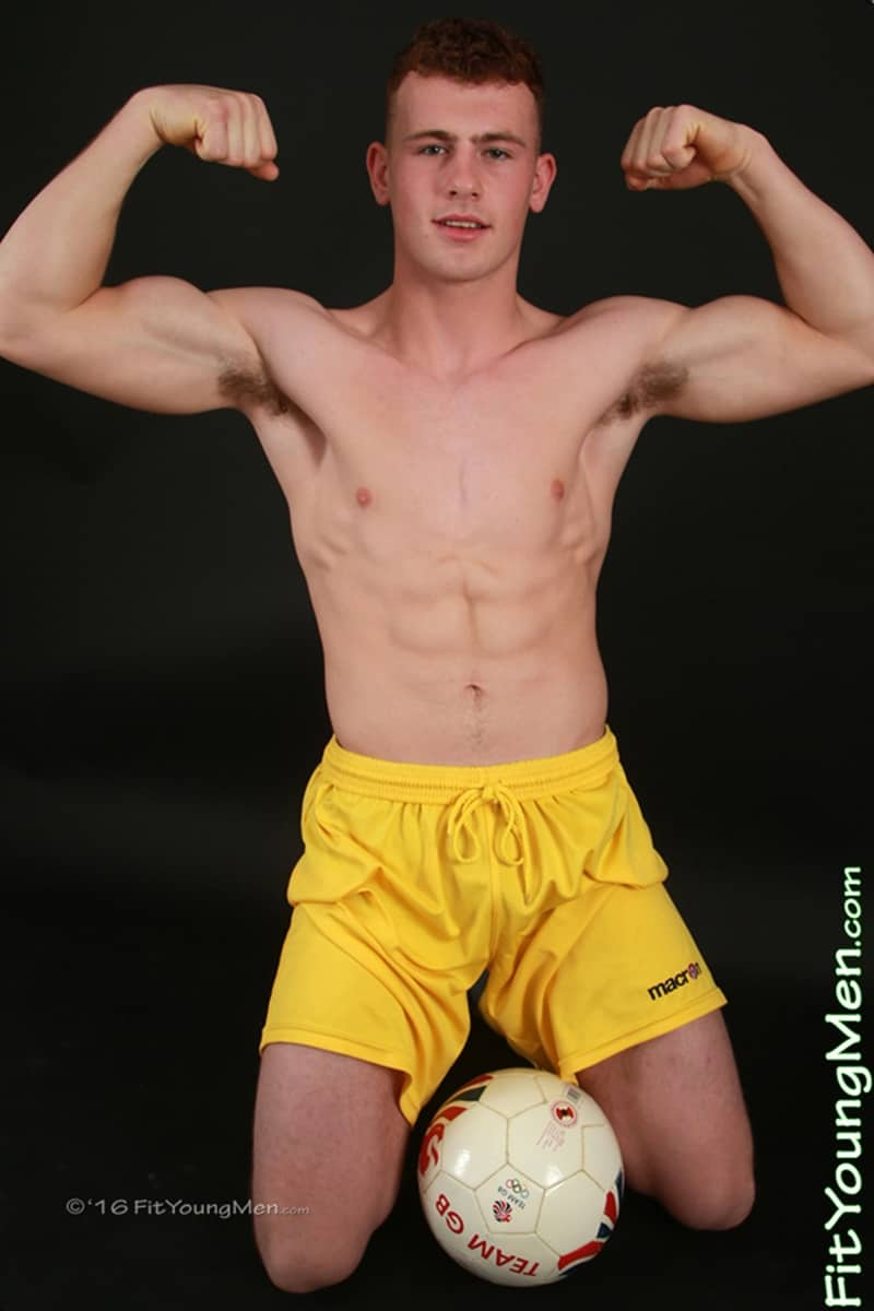 Ripped-young-muscle-stud-Tom-Stevens-strips-football-kit-wanking-big-uncut-dick-FitYoungMen-005-Gay-Porn-Pics